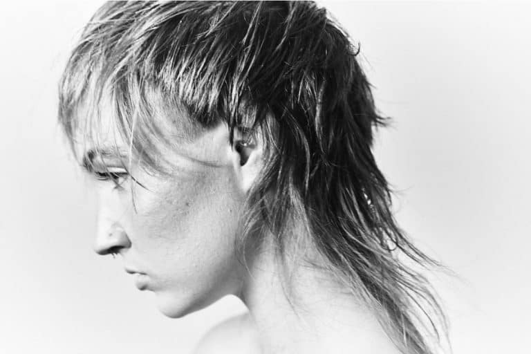 Side view of hairstyle model at Scottfree Salon Milwaukee